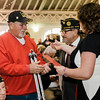 Vietnam Veteran George Schroeder is presented with a pin and certificate during Fitchburg's Veterans Day ceremony on Friday morning at the Senior Center. SENTINEL & ENTERPRISE / Ashley Green