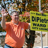 Fitchburg Ward 3 candidates where out campaigning at the polls in front of Memorial Middle School on Tuesday, September 24, 2019. Candidate Mike DiPietro waves to the motorists as they enter the driveway at the polls. SENTINEL & ENTERPRISE/JOHN LOVE