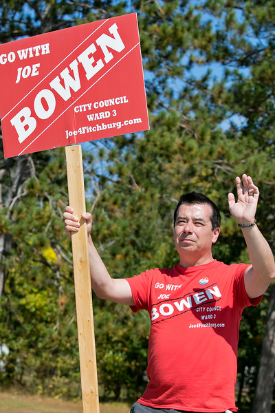 Fitchburg Ward 3 candidates where out campaigning at the polls in front of Memorial Middle School on Tuesday, September 24, 2019. Candidate Joe Bowen waves to the motorists as they enter the driveway at the polls. SENTINEL & ENTERPRISE/JOHN LOVE
