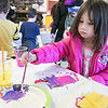 Zoee French, 4, from Fitchburg paints a popsicle craft Saturday, Feb. 1, 2020 at Winterfest held at Coggshall Park in Fitchburg. SENTINEL & ENTERPRISE/JOHN LOVE