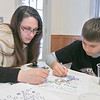 Cynthia Draleaus and her son Justice Pearl, 10, from Fitchburg work on coloring a picture Saturday, Feb. 1, 2020 at Winterfest held at Coggshall Park in Fitchburg. SENTINEL & ENTERPRISE/JOHN LOVE
