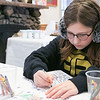 Coloring Saturday, Feb. 1, 2020 at Winterfest held at Coggshall Park in Fitchburg is Hannah Couture, 11, from Fitchburg. SENTINEL & ENTERPRISE/JOHN LOVE