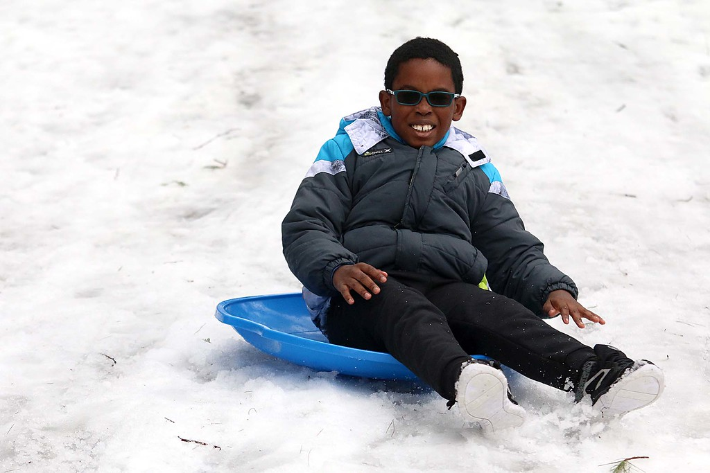 . Sledding at the Fitchburg Winterfest at Coggshall Park is Warren Walters, 7, of Fitchburg. SENTINEL & ENTERPRISE/JOHN LOVE