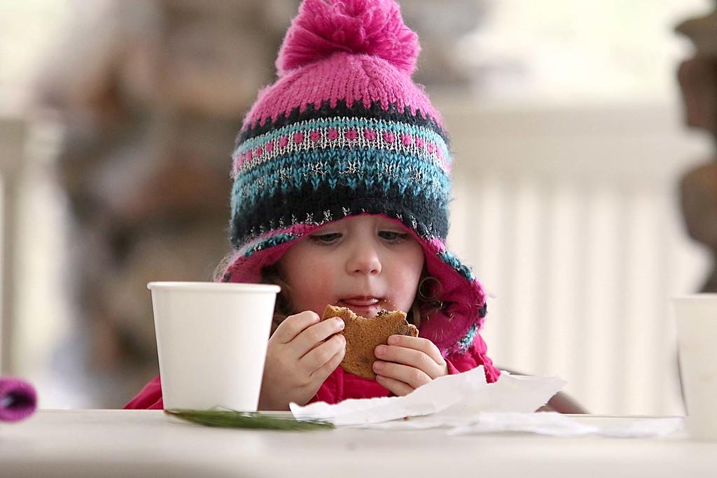 . Enjoying a cookie at the Fitchburg Winterfest at Coggshall Park is Quinn Dickhaut, 3. SENTINEL & ENTERPRISE/JOHN LOVE