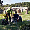 From left, Ben Pitre, Justin Doucette, Austin Pitre and Ali Chartier work to clear veterans' markers at Forest Hill Cemetery in Fitchburg on Sept. 24, 2016.<br /> PHOTO SUBMITTED BY DON SPARKS