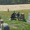 Sam Boyle, left, and Austin Pitre work together clearing a veteran's marker at Forest Hill Cemetery.<br /> PHOTO SUBMITTED BY DON SPARKS