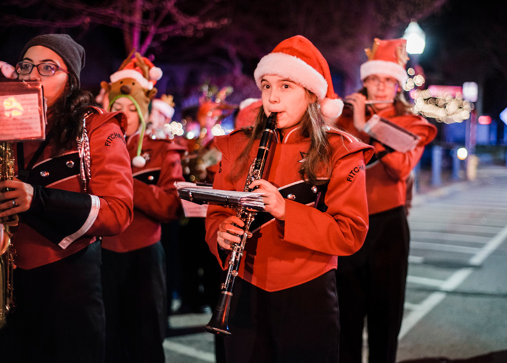 . The Fitchburg High School Marching Band performs as families gather at Monument Park in Fitchburg to greet Santa ahead of the annual tree lighting on Saturday, December 2, 2017. SENTINEL & ENTERPRISE / Ashley Green