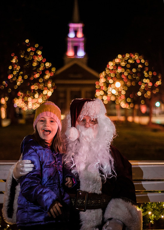 . Venetia Boss, 9, excitedly greets Santa on the Upper Common during the annual tree lighting in Fitchburg on Saturday, December 2, 2017. SENTINEL & ENTERPRISE / Ashley Green