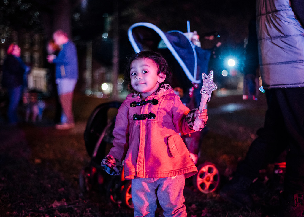 . Catalena Forest, 2,  plays with a lighted wand on the Upper Common during the annual tree lighting in Fitchburg on Saturday, December 2, 2017. SENTINEL & ENTERPRISE / Ashley Green