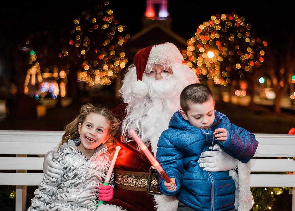 . Alexandra, 5, and Dominic Serrano, 4, greet Santa on the Upper Common during the annual tree lighting in Fitchburg on Saturday, December 2, 2017. SENTINEL & ENTERPRISE / Ashley Green
