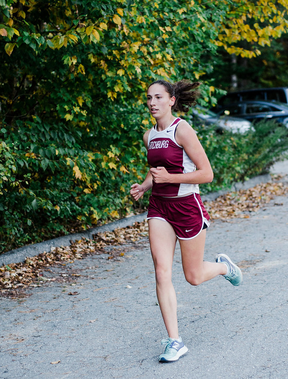 . Fitchburg\'s Hannah Neilon approaches with a first place finish during the cross country meet against Leominster at Coggshall Park in Fitchburg on Tuesday, October 17, 2017. SENTINEL & ENTERPRISE / Ashley Green