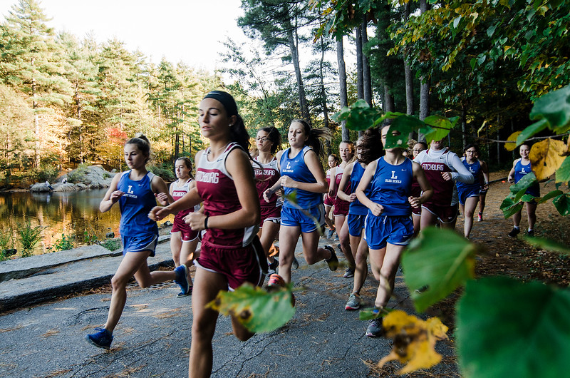 The Fitchburg and Leominster girls cross country teams take off at the start of the race at Coggshall Park in Fitchburg on Tuesday, October 17, 2017. SENTINEL & ENTERPRISE / Ashley Green