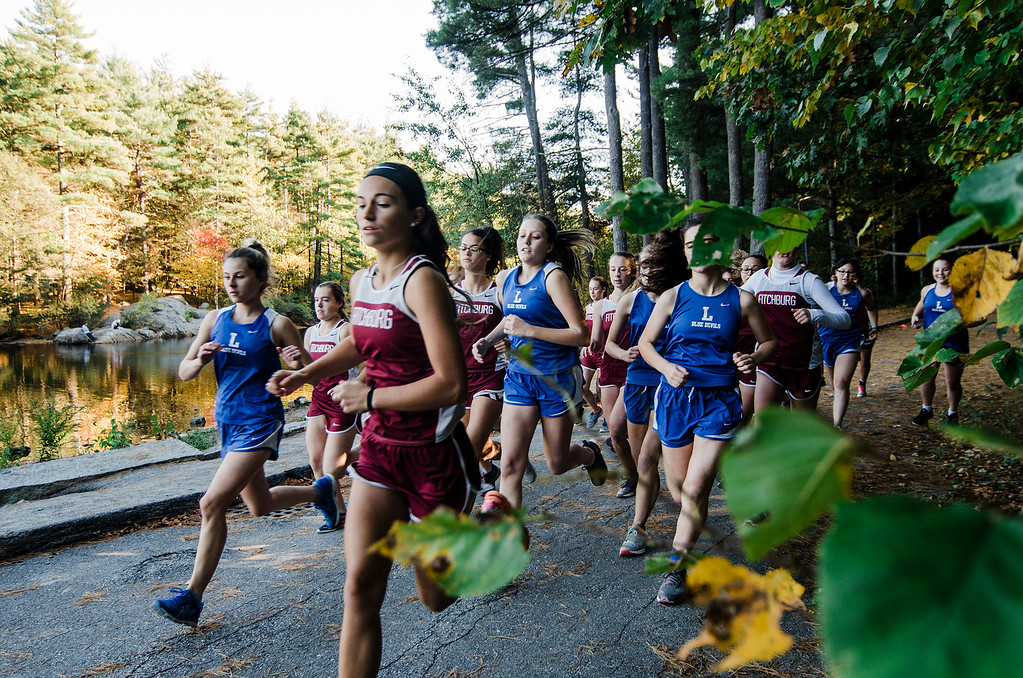 . The Fitchburg and Leominster girls cross country teams take off at the start of the race at Coggshall Park in Fitchburg on Tuesday, October 17, 2017. SENTINEL & ENTERPRISE / Ashley Green
