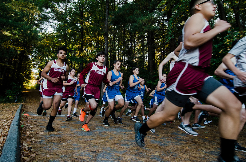 The Fitchburg and Leominster boys cross country teams take off at the start of the race at Coggshall Park in Fitchburg on Tuesday, October 17, 2017. SENTINEL & ENTERPRISE / Ashley Green