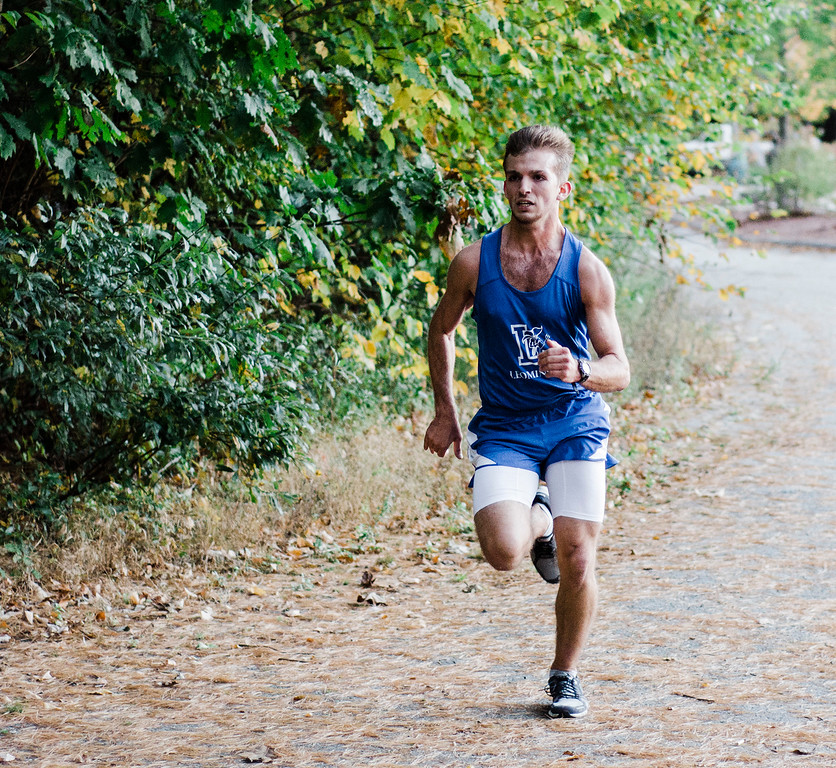 . Leominster\'s Nick Malm approaches with a first place finish during the cross country meet against Fitchburg at Coggshall Park in Fitchburg on Tuesday, October 17, 2017. SENTINEL & ENTERPRISE / Ashley Green