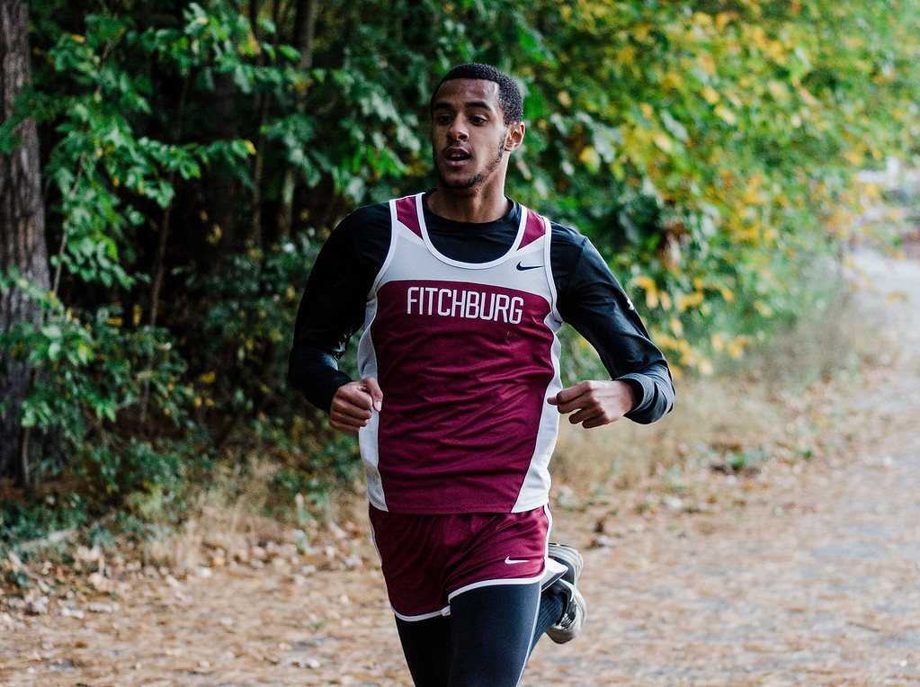 . Fitchburg\'s Angel Figueroa approaches with a second place finish during the cross country meet against Leominster at Coggshall Park in Fitchburg on Tuesday, October 17, 2017. SENTINEL & ENTERPRISE / Ashley Green