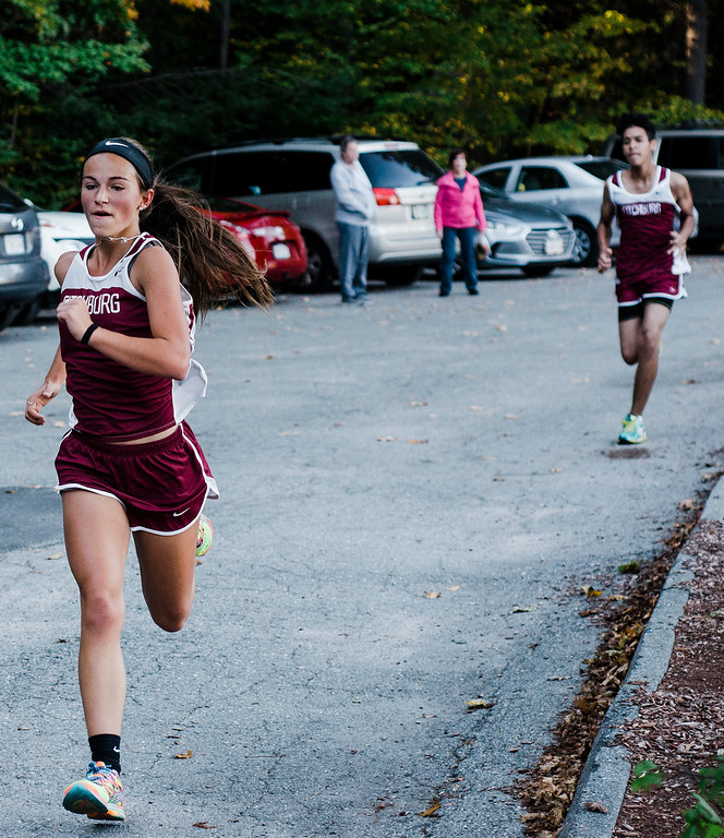 . Fitchburg\'s Kam Pelland approaches with a third place finish during the cross country meet against Leominster at Coggshall Park in Fitchburg on Tuesday, October 17, 2017. SENTINEL & ENTERPRISE / Ashley Green