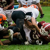 The Marlborough defense brings down Fitchburg's Alex Marrero on Saturday morning. SENTINEL & ENTERPRISE / Ashley Green