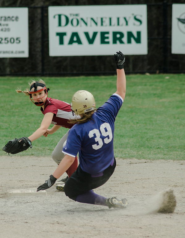 . Fitchburg\'s Emma Auger attempts to tag out Monty Tech\'s Kyra Tammaro during the game on Wednesday, April 19, 2017. SENTINEL & ENTERPRISE / Ashley Green