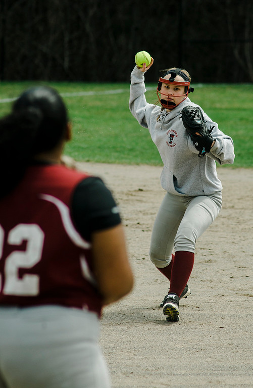 . Fitchburg\'s Emma Auger throws a runner out at first base during the game against Monty Tech on Wednesday, April 19, 2017. SENTINEL & ENTERPRISE / Ashley Green