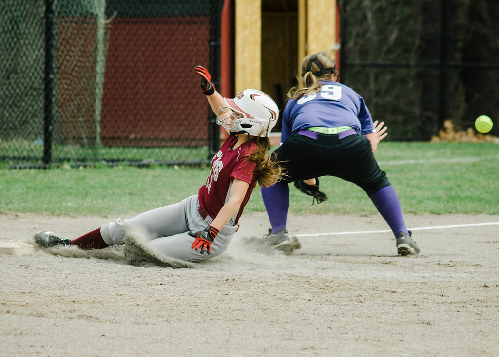 . Fitchburg\'s Kammarie Pelland slides safely into third during the game against Monty Tech on Wednesday, April 19, 2017. SENTINEL & ENTERPRISE / Ashley Green