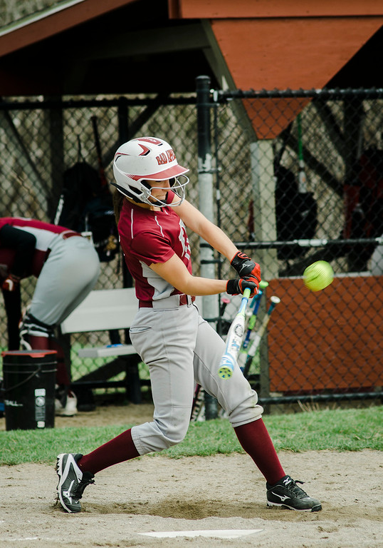 . Fitchburg\'s Kammarie Pelland connects with a pitch during the game against Monty Tech on Wednesday, April 19, 2017. SENTINEL & ENTERPRISE / Ashley Green