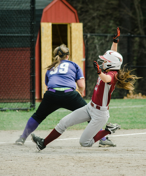 Fitchburg's Kammarie Pelland slides safely into third during the game against Monty Tech on Wednesday, April 19, 2017. SENTINEL & ENTERPRISE / Ashley Green