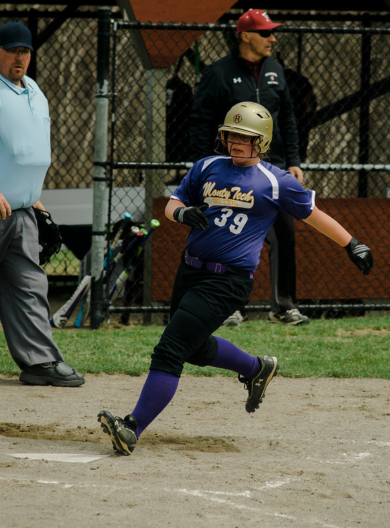 . Monty Tech\'s Kyra Tammaro scores a run during the game against Fitchburg High on Wednesday, April 19, 2017. SENTINEL & ENTERPRISE / Ashley Green