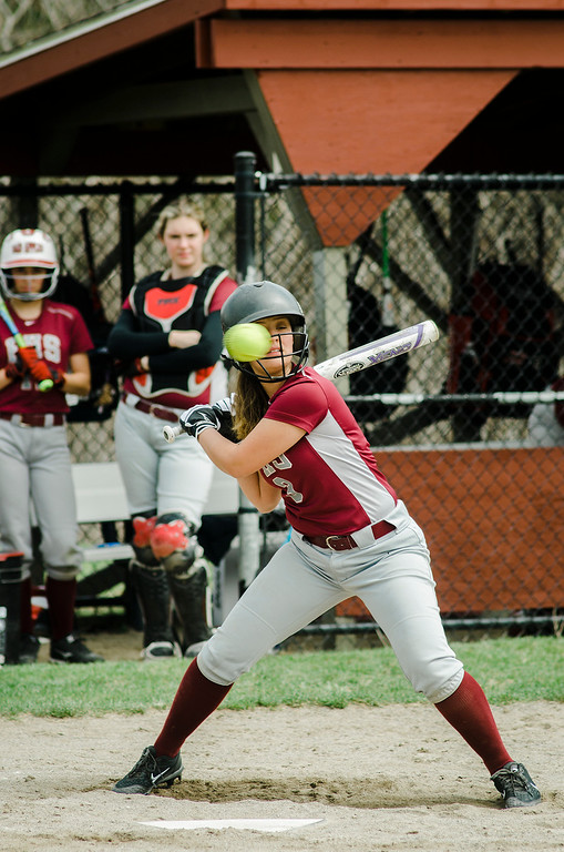. Fitchburg\'s Alydia Le lets a high pitch pass by during the game against Monty Tech on Wednesday, April 19, 2017. SENTINEL & ENTERPRISE / Ashley Green