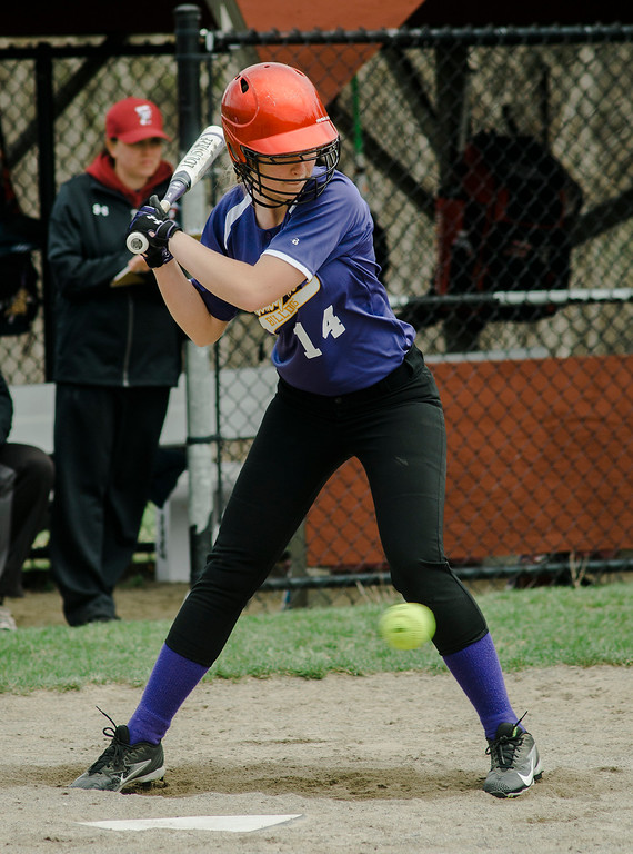 . Monty Tech\'s Cassie Skinner watches a low pitch during the game against Fitchburg High on Wednesday, April 19, 2017. SENTINEL & ENTERPRISE / Ashley Green