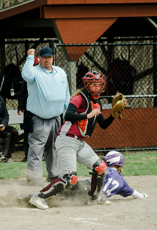 . Fitchburg\'s Audrey Johnson tags Monty Tech\'s Chelsea Simmers-Swanson out at home during the game on Wednesday, April 19, 2017. SENTINEL & ENTERPRISE / Ashley Green