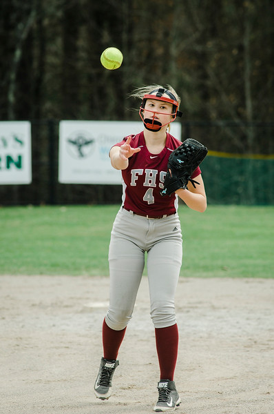 Fitchburg's Emma Auger throws a runner out at first base during the game against Monty Tech on Wednesday, April 19, 2017. SENTINEL & ENTERPRISE / Ashley Green
