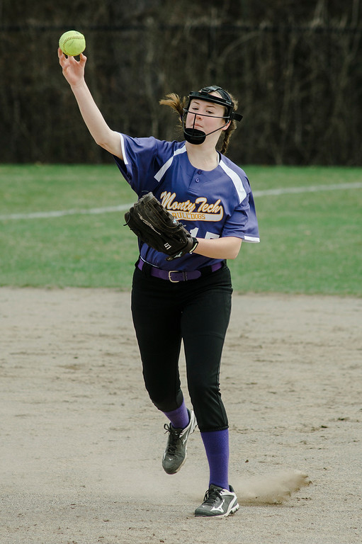 . Monty Tech\'s Sarah Parker throws a runner out at first during the game against Fitchburg High on Wednesday, April 19, 2017. SENTINEL & ENTERPRISE / Ashley Green