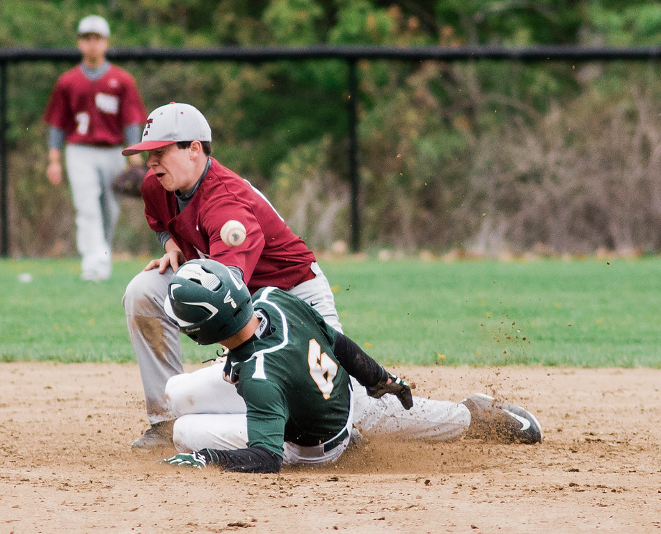 . Oakmont\'s Greg Mattson slides safely under the tag of Fitchburg\'s Sammy Robichaud during the game on Wednesday, May 10, 2017. SENTINEL & ENTERPRISE / Ashley Green