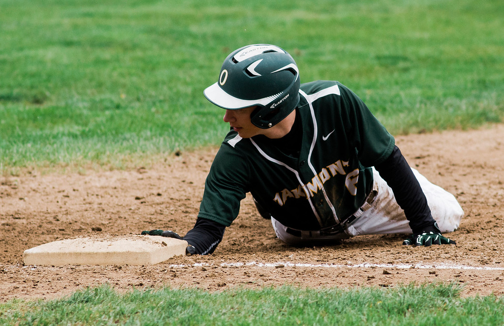 . Oakmont\'s Greg Mattson dives back to first during the game against Fitchburg on Wednesday, May 10, 2017. SENTINEL & ENTERPRISE / Ashley Green