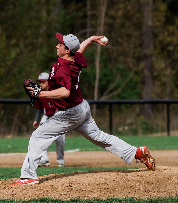 . Fitchburg\'s Jameson Carroll delivers a pitch during the game against Oakmont on Wednesday, May 10, 2017. SENTINEL & ENTERPRISE / Ashley Green