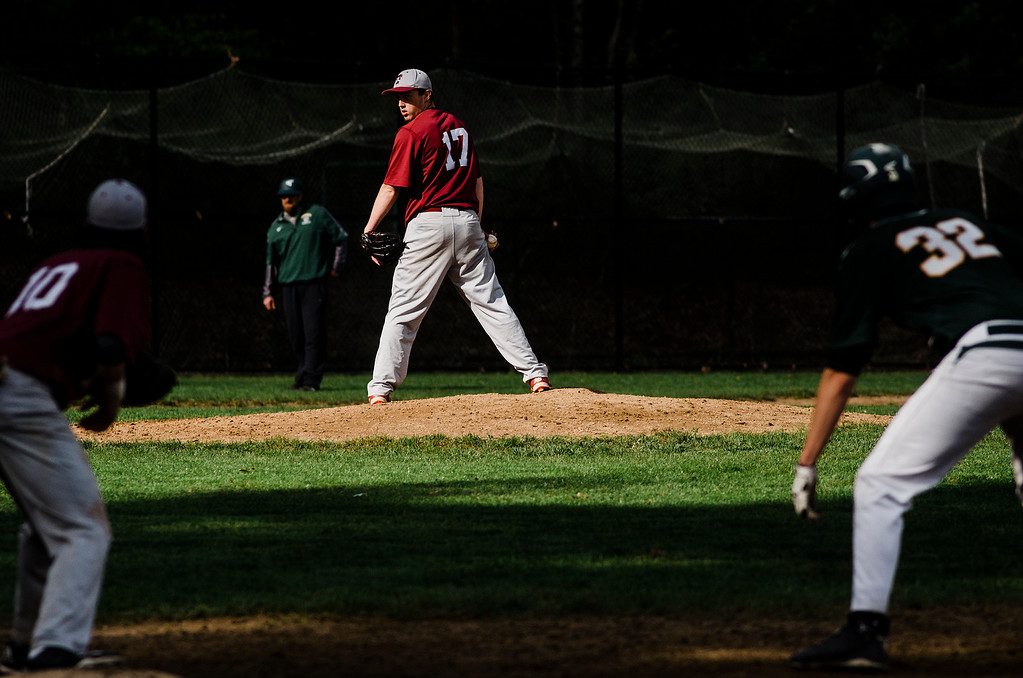 . Fitchburg\'s Jameson Carroll looks a runner back to first during the game against Oakmont on Wednesday, May 10, 2017. SENTINEL & ENTERPRISE / Ashley Green