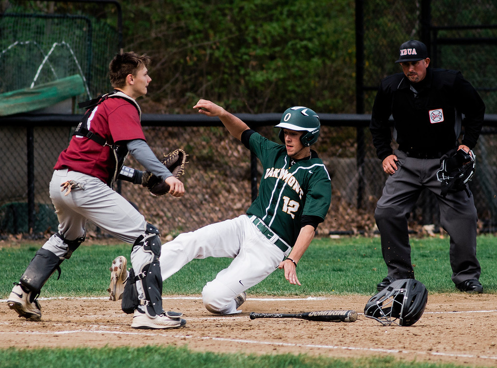 . Oakmont\'s Tim O\'Connor scores a run ahead of the tag of Fitchburg\'s Austin English during the game at FHS on Wednesday, May 10, 2017. SENTINEL & ENTERPRISE / Ashley Green