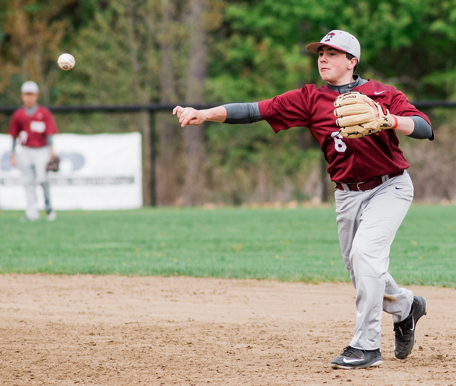 . Fitchburg\'s Sammy Robichaud makes a play to first during the game against Oakmont on Wednesday, May 10, 2017. SENTINEL & ENTERPRISE / Ashley Green