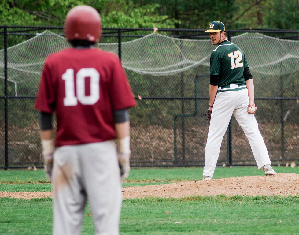 . Oakmont pitcher Tim O\'Connor looks a Fitchburg baserunner back to first during the game at FHS on Wednesday, May 10, 2017. SENTINEL & ENTERPRISE / Ashley Green