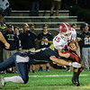 Fitchburg quarterback Andrew Brooks is brought down by the defense during the loss to Shrewsbury on Saturday evening. SENTINEL & ENTERPRISE / Ashley Green