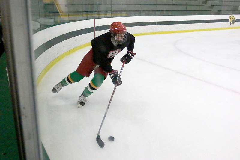 Fitchburg/ Monty Tech High School Hockey player junior Brendon Garneau takes the puck out of the corner during a drill at practice on Tuesday at the Wallace Civic Center. SENTINEL & ENTERPRISE/JOHN LOVE