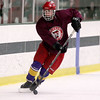 Fitchburg/ Monty Tech High School Hockey player junior Thomas Wilbur tries to control the puck during a drill at practice on Tuesday at the Wallace Civic Center. SENTINEL & ENTERPRISE/JOHN LOVE