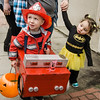Little Batgirl Madelyn Ioshua, 1, checks out fireman Matthew Lang, 3, during trick-or-treating in downtown Fitchburg on Saturday afternoon. SENTINEL & ENTERPRISE / Ashley Green