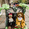 Milah McDonald and Dakota Reardon ride in style during trick-or-treating in downtown Fitchburg on Saturday afternoon. SENTINEL & ENTERPRISE / Ashley Green