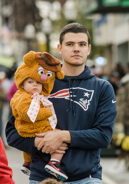 Henry Pucko, 1, gets a life from dad Chris during trick-or-treating in downtown Fitchburg on Saturday afternoon. SENTINEL & ENTERPRISE / Ashley Green