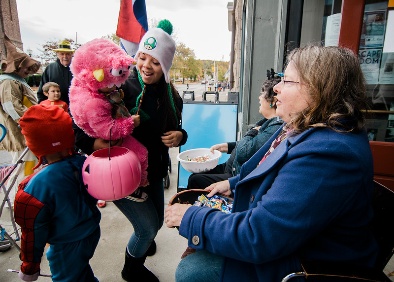Adreanna and Rylee Boggs, 1, participate in trick-or-treating in downtown Fitchburg. SENTINEL & ENTERPRISE / Ashley Green