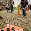 Walter Johnson, 11,  plays a game during trick-or-treating in downtown Fitchburg on Saturday afternoon. SENTINEL & ENTERPRISE / Ashley Green