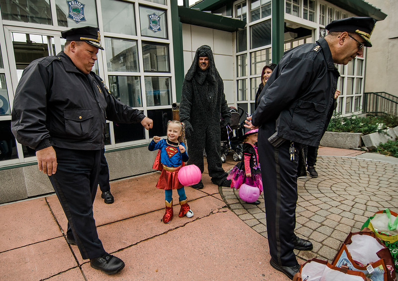 Frankie Chevrette, 4, fist-bumps Police Chief Ernie Martineau during trick-or-treating in downtown Fitchburg on Saturday afternoon. SENTINEL & ENTERPRISE / Ashley Green