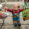 Kellen Mallard goes for some candy during trick-or-treating in downtown Fitchburg on Saturday afternoon. SENTINEL & ENTERPRISE / Ashley Green